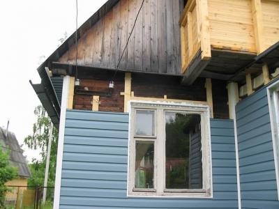 Надо ли обшивать дом из бруса