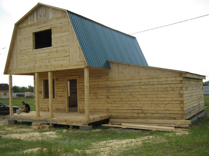 Деревянные дома из бруса с гаражом: выбираем функциональный проект