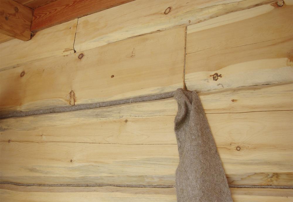 Конопатка брусового дома джутом